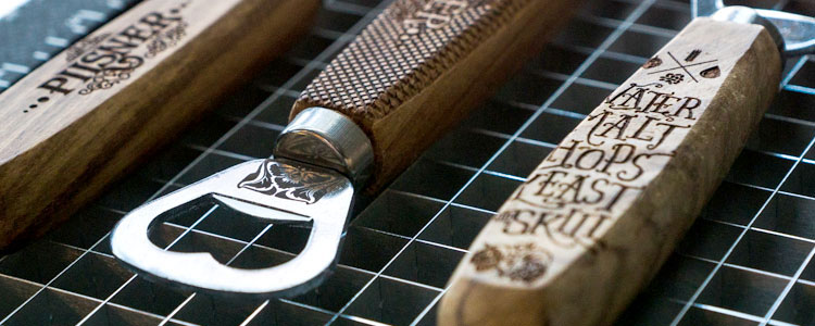 Bottle openers engraved with a dual-source Epilog laser machine