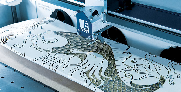 A laser engraved skateboard with a 3D fish design