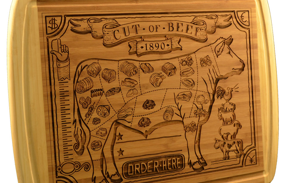Wood engraving with a laser on a cutting board.