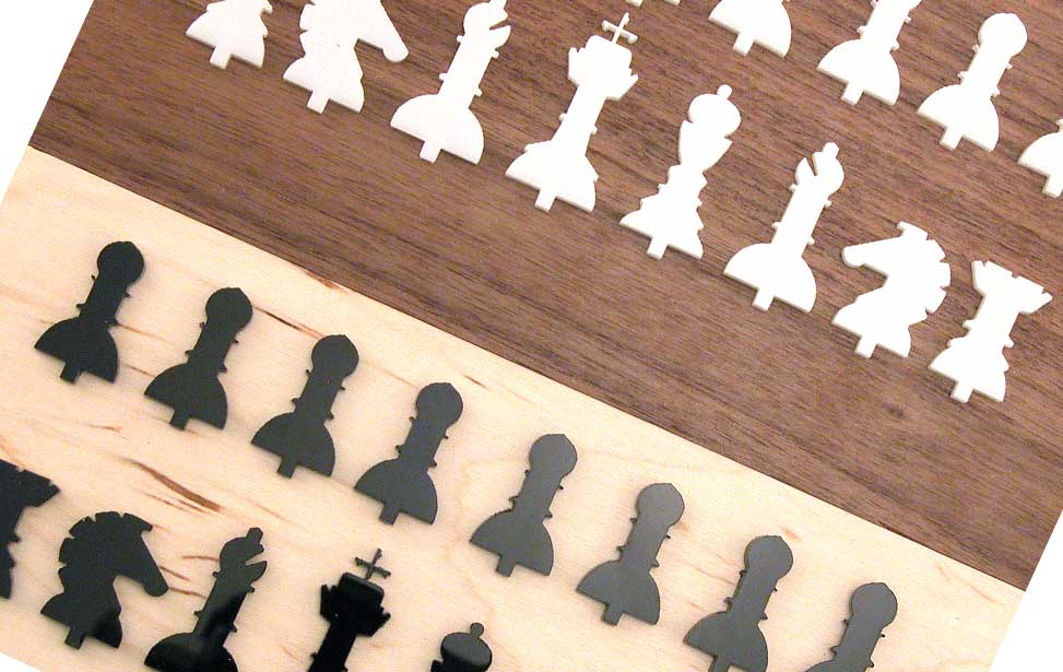 Chess pieces after laser cutting.