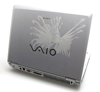 laser engraved laptop with lionfish.