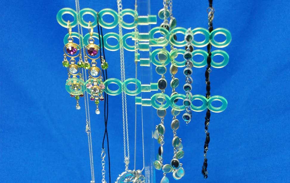 Colorful laser cut acrylic jewelry holder.
