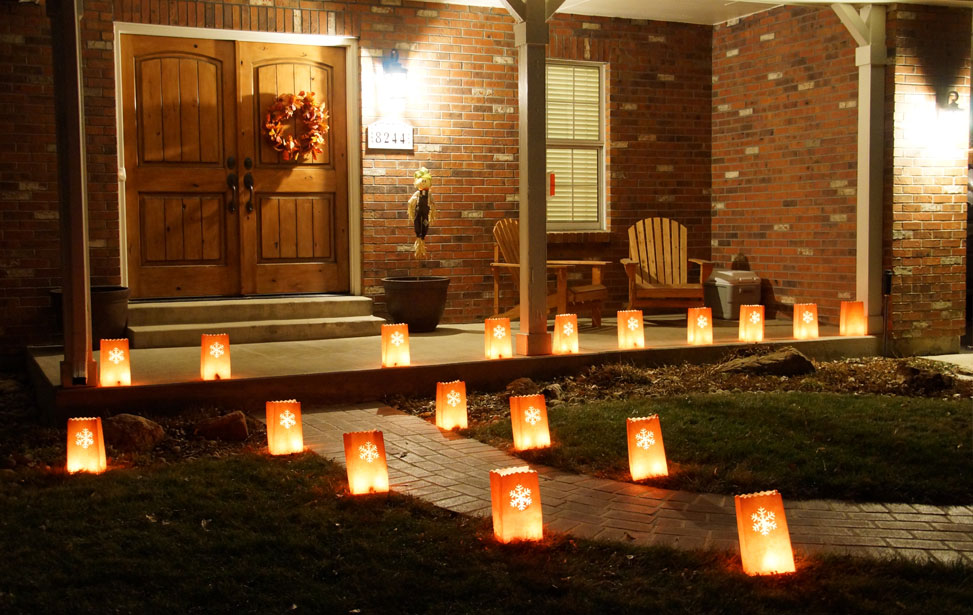 laser cut luminarias in front of the house
