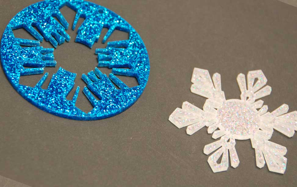 Inlaid acrylic snowflake pieces.