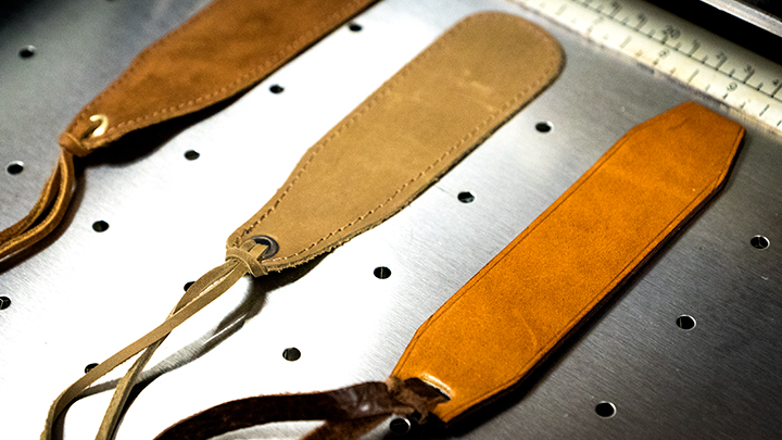 leather bookmark placed in the laser system