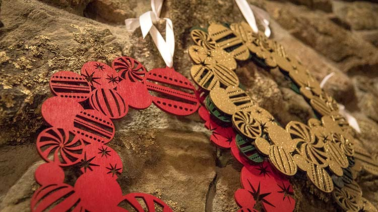 Close up of laser cut Christmas wreaths.